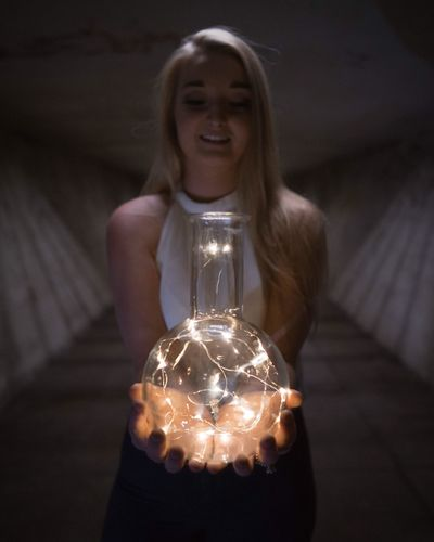 Illuminated Indoors  Front View Real People One Person Holding Electricity  Light Bulb Young Adult Spooky Young Women Standing Close-up