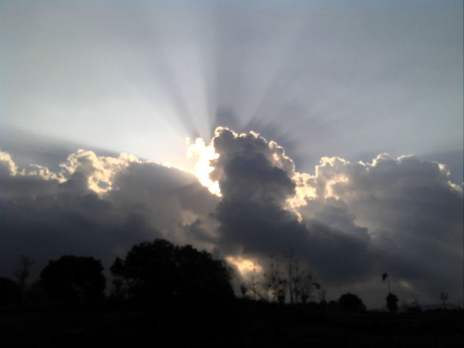 Beauty In Nature Cloudy Outdoors Silhouette Sky Sun Sunset