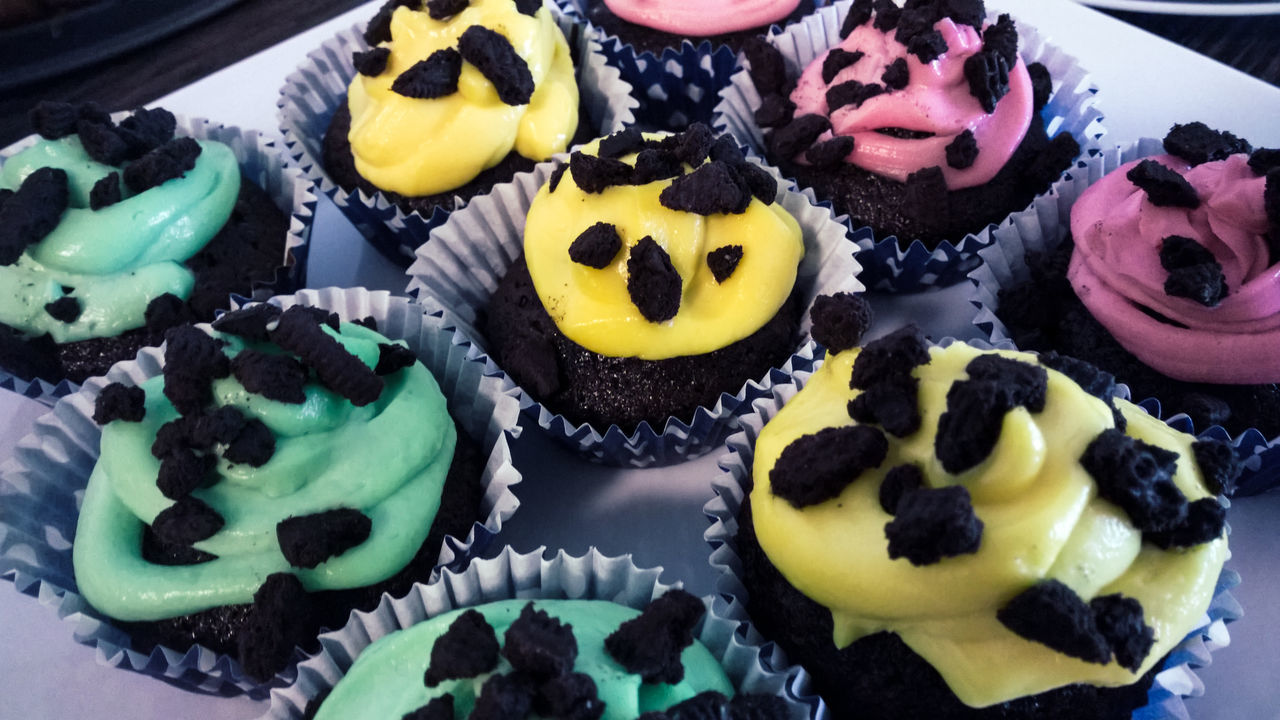 Chocolate Close-up Cupcake Day Dessert Food Food And Drink Freshness Green Color High Angle View Indoors  Indulgence Multi Colored No People Pink Color Plate Ready-to-eat Still Life Sweet Food Table Temptation Unhealthy Eating Variation Yellow Color