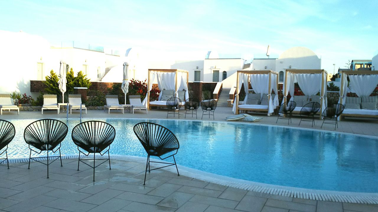 swimming pool, chair, water, sky, luxury, day, outdoors, no people, luxury hotel, vacations, architecture, building exterior