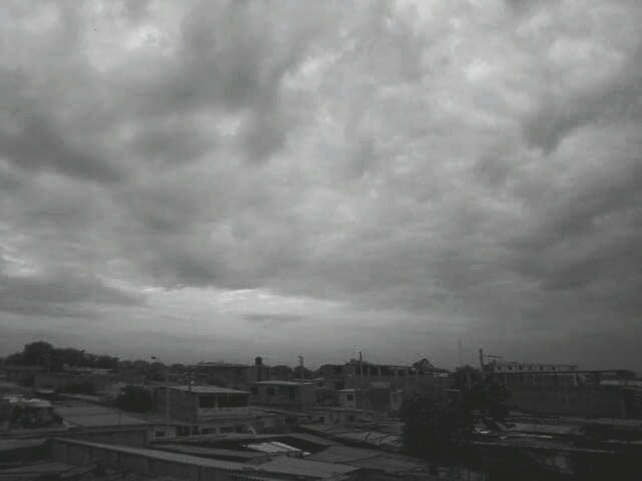 cloud - sky, building exterior, architecture, sky, built structure, weather, storm cloud, outdoors, city, nature, no people, day, tree, cityscape, thunderstorm