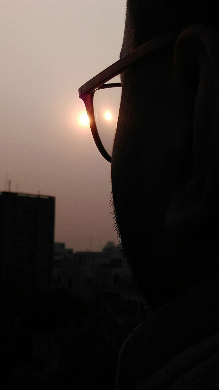sunset, sun, silhouette, sky, close-up, outdoors, real people, one person, nature, architecture, city, day, people