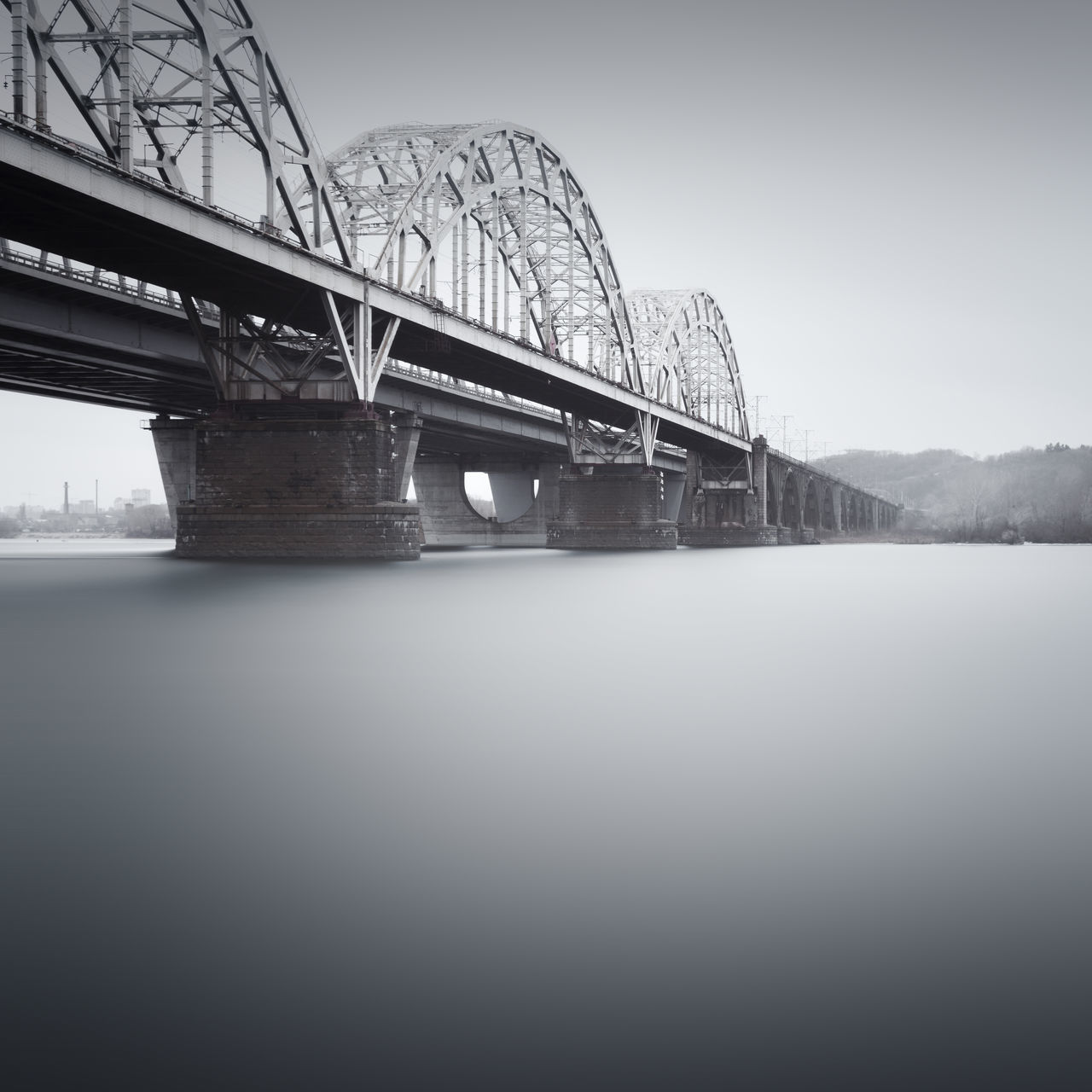 low angle view of bridge over river against clear sky Architecture Bridge - Man Made Structure Built Structure Clear Sky Connection Day Engineering Kyiv Low Angle View Muted Colors Nature New Darnytskyi Bridge No People Outdoors Philipp Dase Railroad Bridge River Sky Transportation Ukraine Water Winter Wintertime