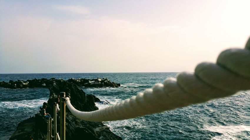 Sky Vintage Rocks Cliff Nature Water Rope Perspective Sea Water Horizon Over Water Outdoors Beach No People Day