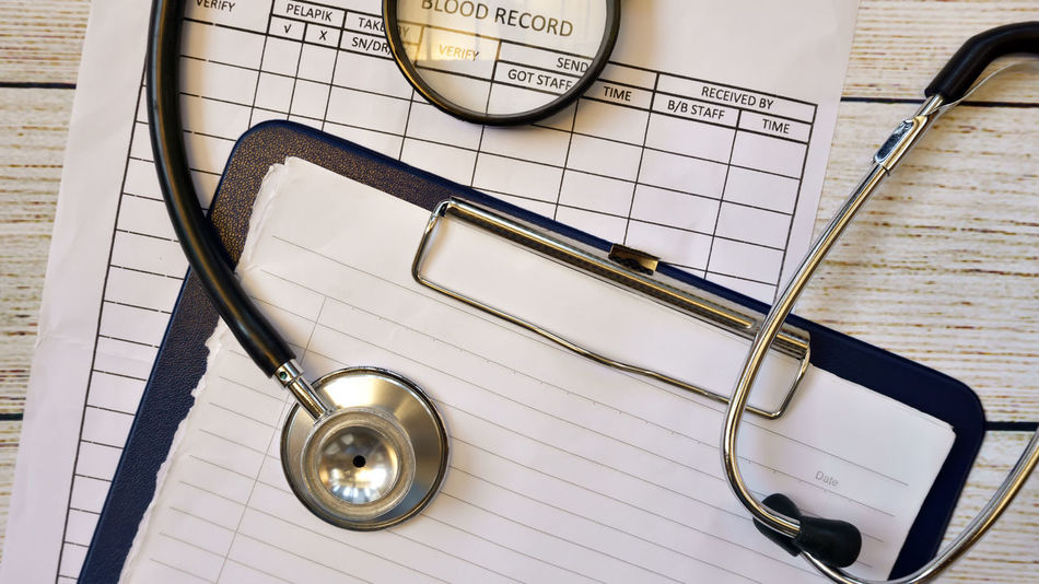 stethoscope and medical report files Blood Test Close-up Conceptual Medical Medical Appoiment Medical Equipment Medical Exam Medical Report Medical Student Top View Shot
