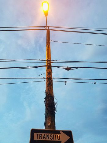 Electricity  Power Line  Fuel And Power Generation Electricity Pylon Cable Power Supply Cloud - Sky Communication Sky Technology EyeEm Ready   Still Life Perspective Shapes And Forms City Street Sign