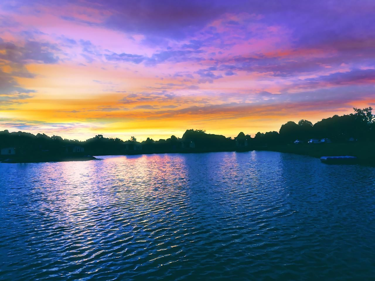 sunset, beauty in nature, scenics, water, tranquil scene, nature, tranquility, sky, lake, idyllic, no people, waterfront, cloud - sky, outdoors, silhouette, rippled, tree, view into land, day