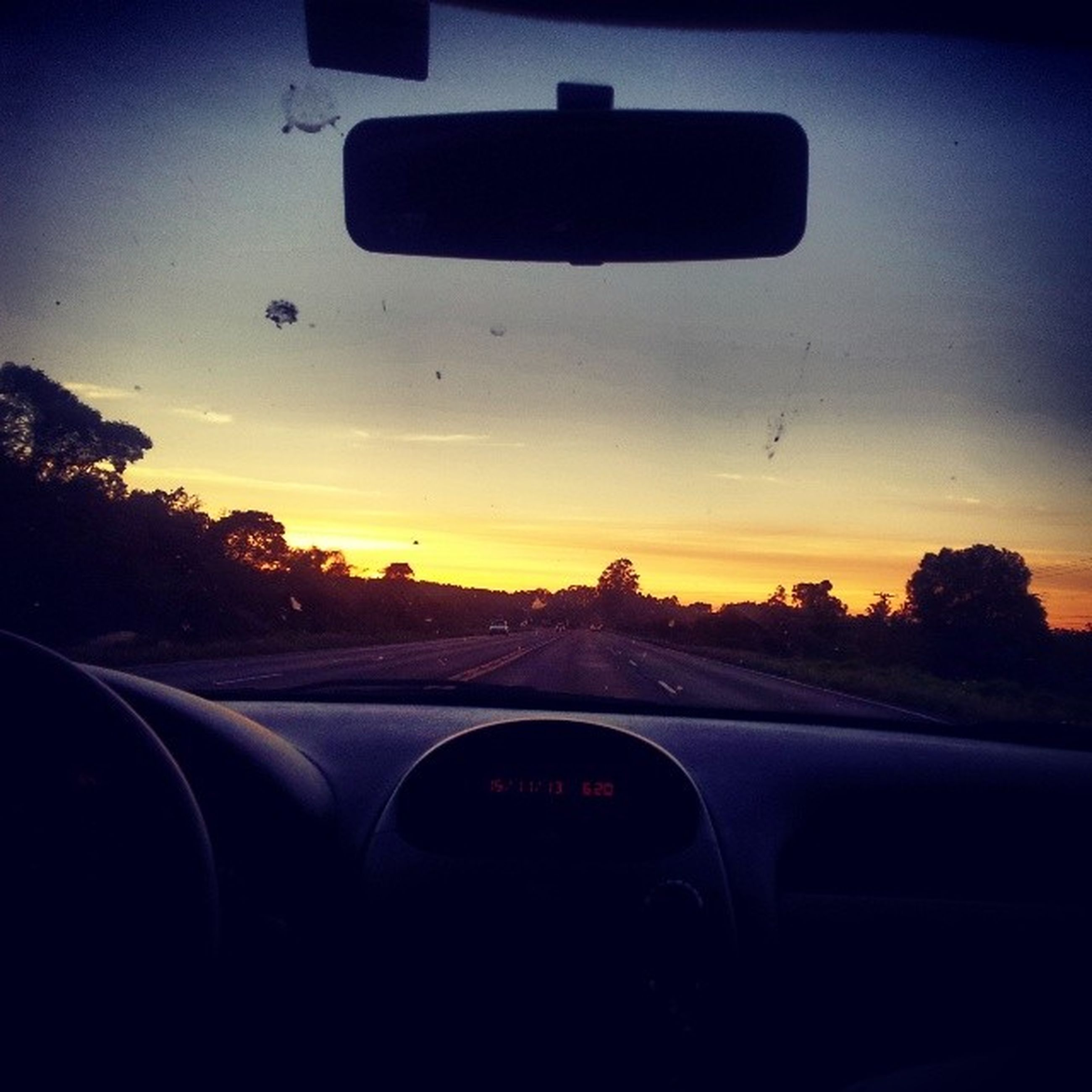 transportation, mode of transport, car, land vehicle, road, sunset, windshield, vehicle interior, car interior, on the move, travel, glass - material, sky, transparent, car point of view, tree, road trip, journey, road marking, part of