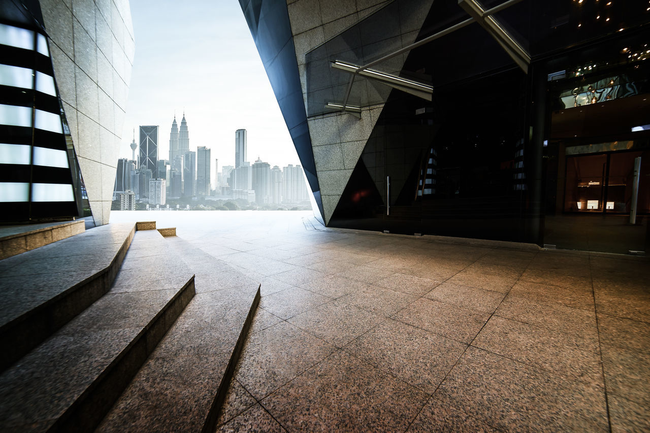 Empty marble stair and floor front of modern polygon design buildings. Architectural Column Architecture Building Exterior Built Structure City Cityscape Day Downtown District Financial District  Low Angle View Modern No People Outdoors Reflection Sky Skyscraper Travel Destinations Urban Skyline