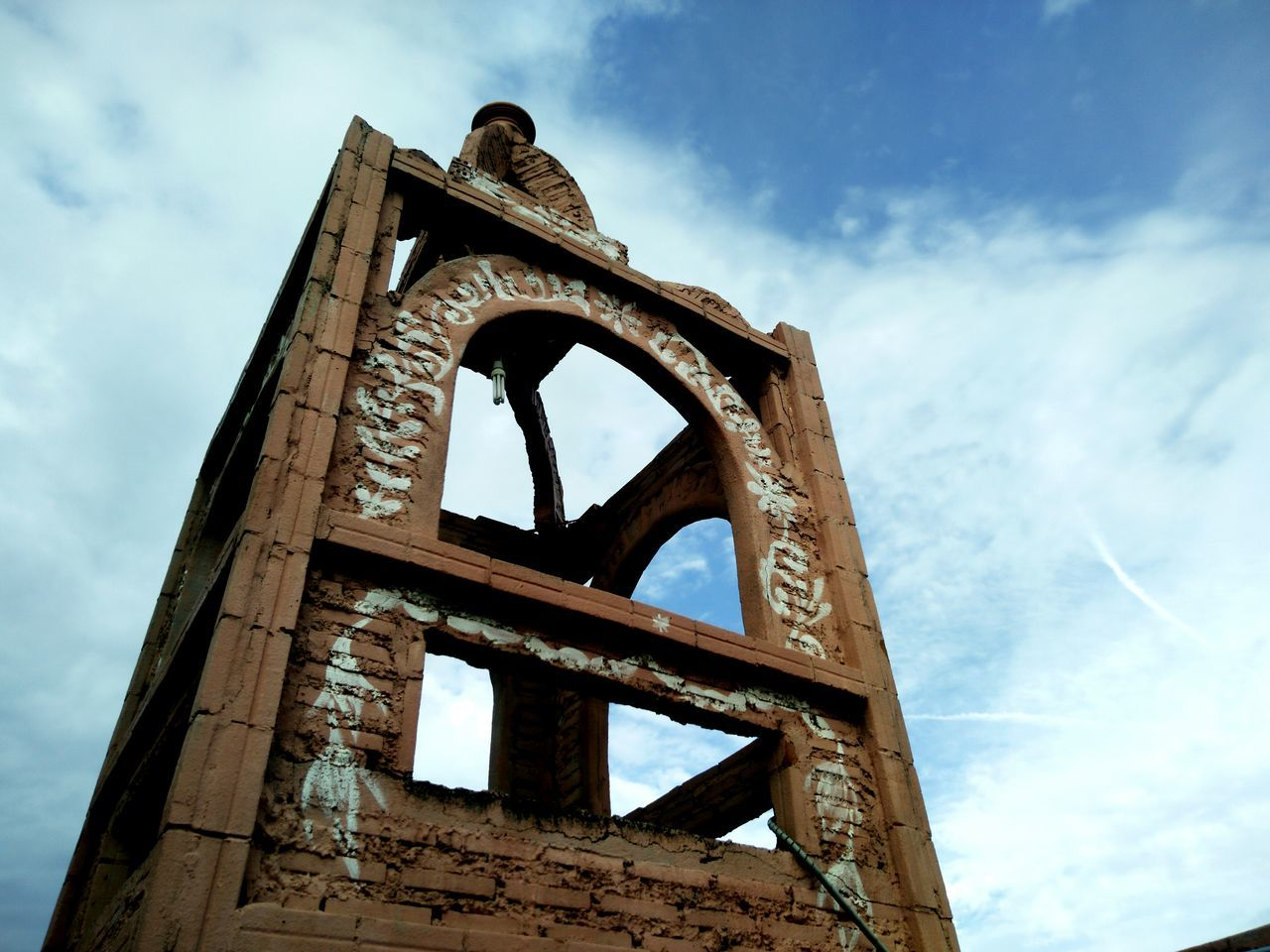 low angle view, sky, cloud - sky, old, day, damaged, built structure, outdoors, architecture, no people, weathered, rusty, history