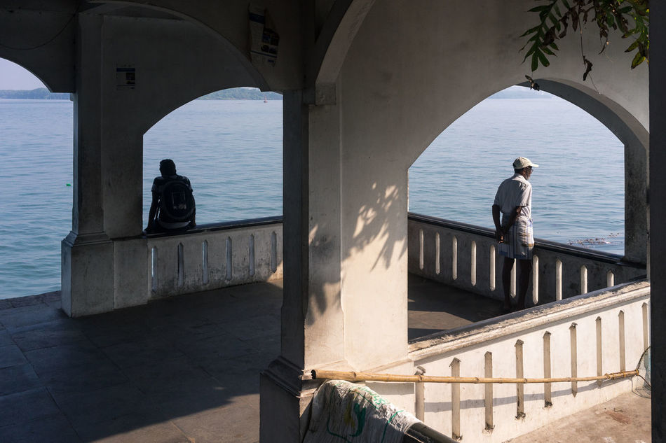 Ferry Landing Contemplation, Kochi, Kerala Cochin Ferry Landing India Kerala Kochi Men Only Men People Railing Real Life Real People Real People Photography Real People, Real Lives Standing Street Photography Streetphotography Travel Travel Destinations Travel Photography