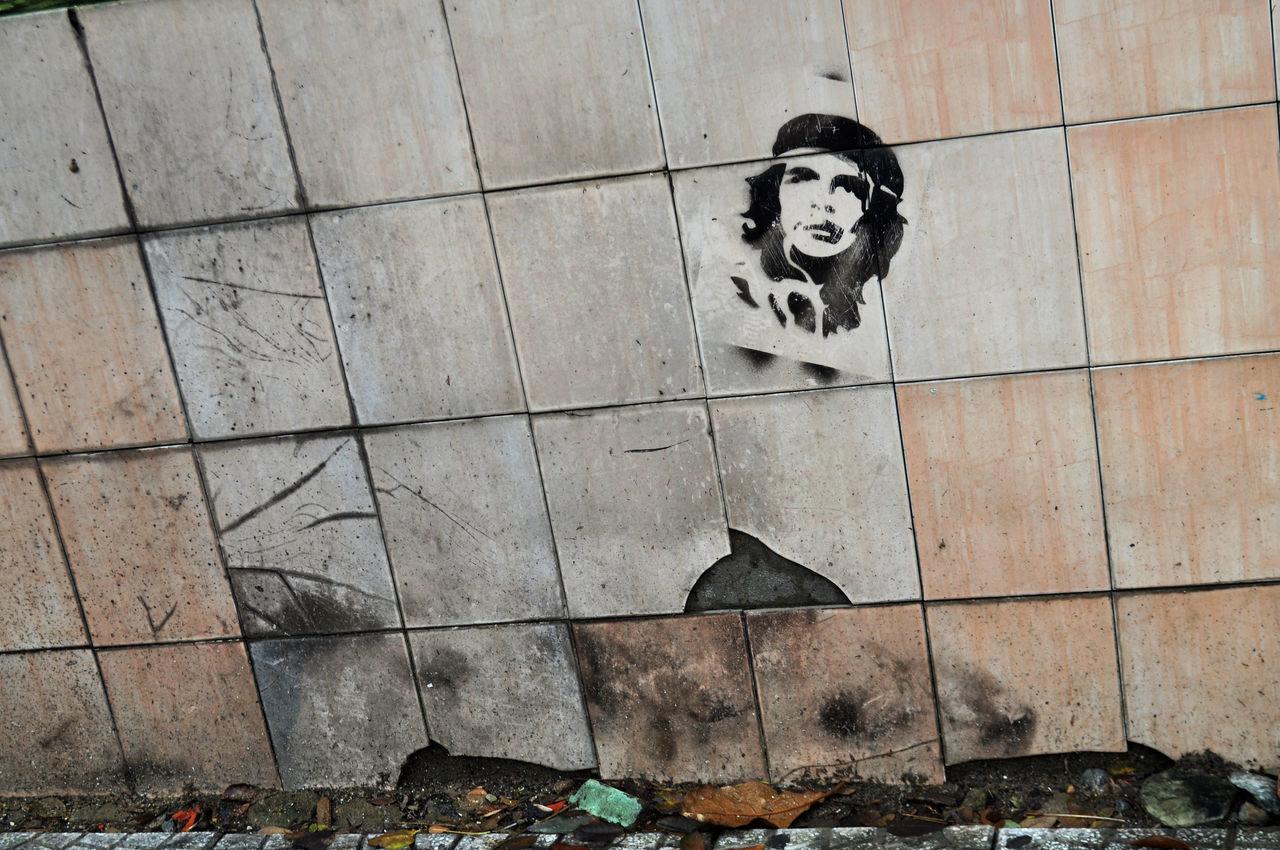 Image of Che Guevara stencilled on wall of military barracks in Da Nang, Vietnam. Barracks Che Guevara Da Nang Day Decay Graffiti Grafitti Heros Ideas Images Military Outdoors Politics Revolutionary Society Stencil Art Tiles Vietnam Walls