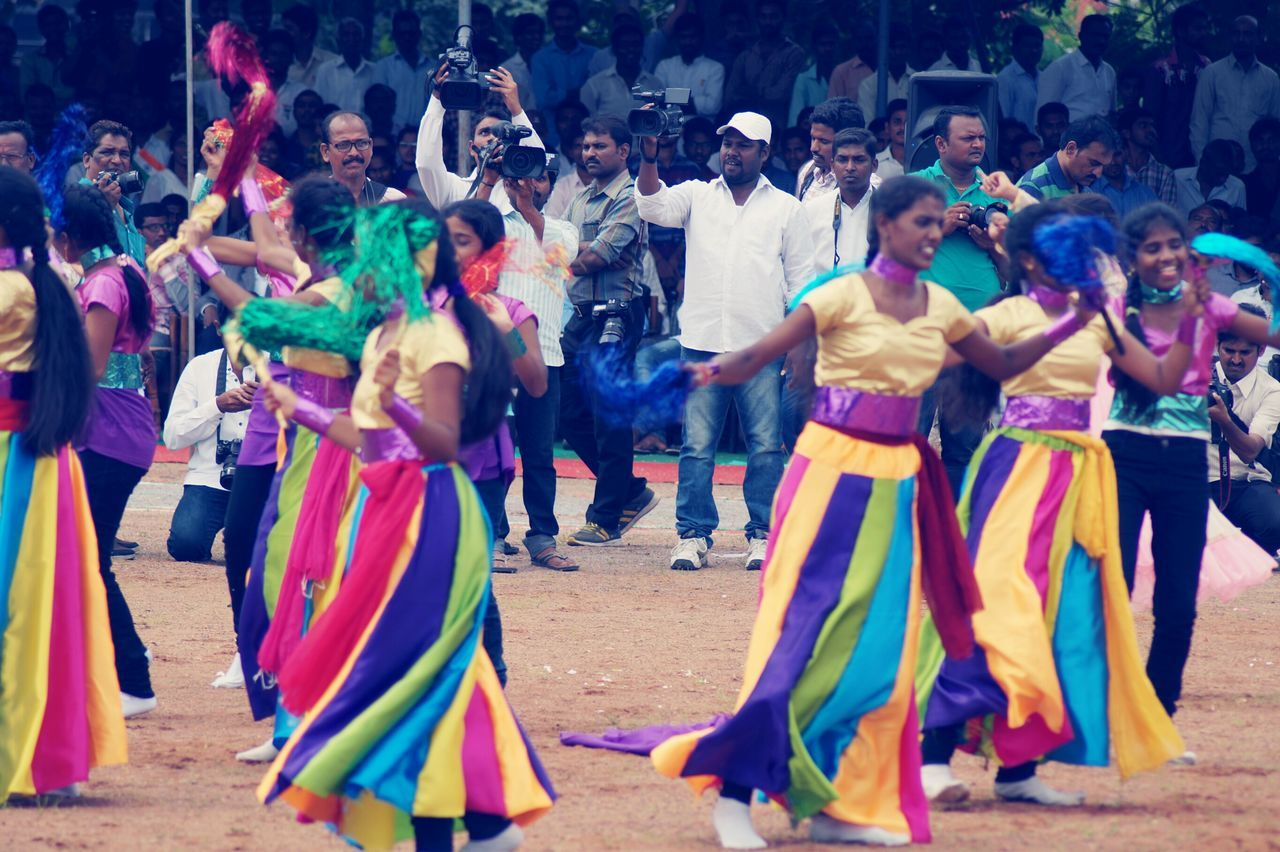large group of people, real people, fun, leisure activity, enjoyment, dancing, lifestyles, multi colored, celebration, men, crowd, performance, full length, day, outdoors, women, togetherness, excitement, adult, people