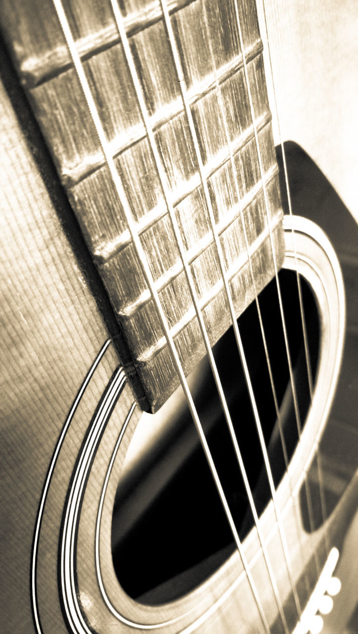 music, musical instrument, musical instrument string, guitar, fretboard, no people, arts culture and entertainment, indoors, string instrument, woodwind instrument, close-up, day