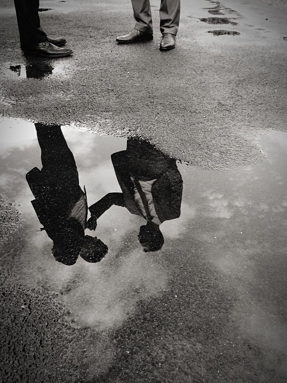 Talking Blackandwhite Reflection Water Reflections Streetphotography Puddle Lookingdown People Talking Talking Pictures Asphalt