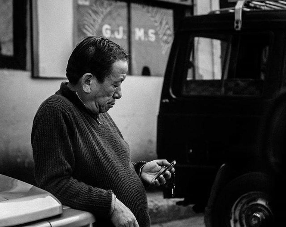A local cab driver checking his cellphone at Cab depot, Darjeeling. . . . . Darjeeling Blackandwhite People Candid Streetportrait Portrait Jj_streetphotography Moodygrams Highcontrast Foto_blackwhite Amateurs_bnw Bnw_planet Bnw_rose Bnw Travel Travelingram Natgeotravel Lonelyplanetindia Ig_india Ig_bengals OnlyinIndia IndiaLove Natgeo Betterphotography Onlyinbengal indiaphotoproject _oye _soi indiastreet