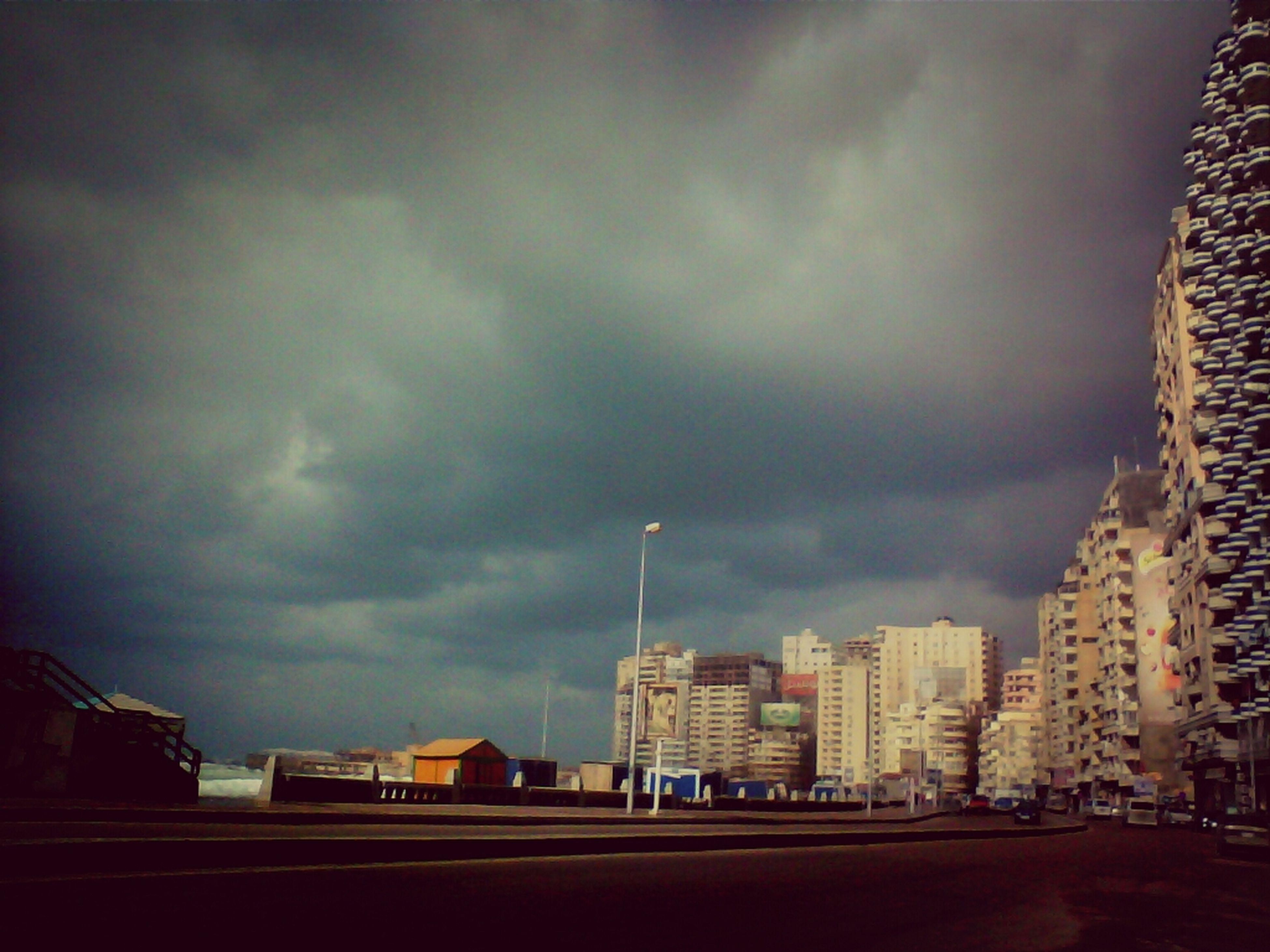 building exterior, architecture, built structure, sky, cloud - sky, cloudy, city, overcast, storm cloud, weather, residential building, building, dusk, cloud, cityscape, residential structure, street, residential district, outdoors, city life