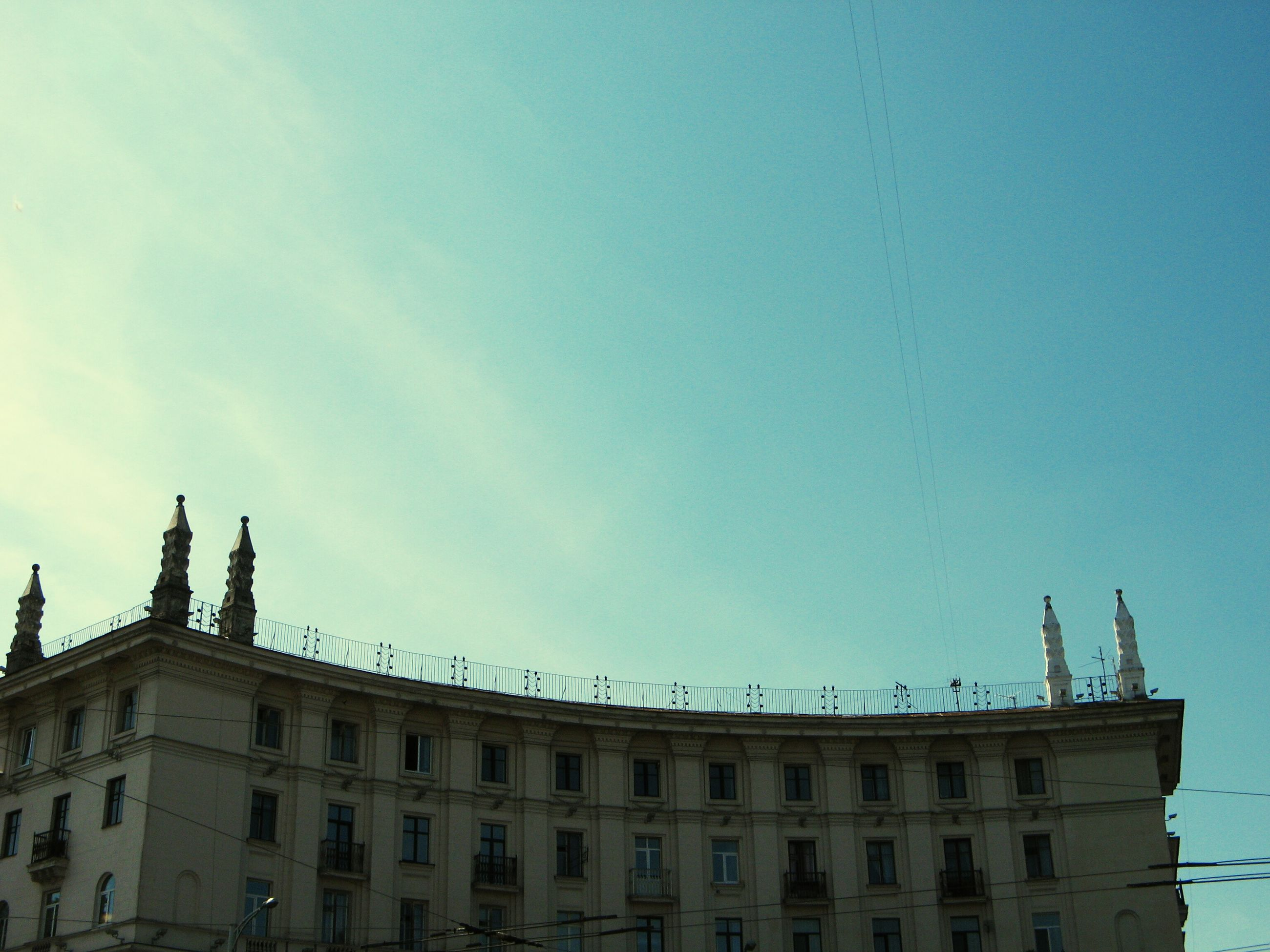 architecture, built structure, low angle view, building exterior, sky, sculpture, statue, art and craft, copy space, art, high section, history, outdoors, building, blue, travel destinations, clear sky, city, famous place, human representation