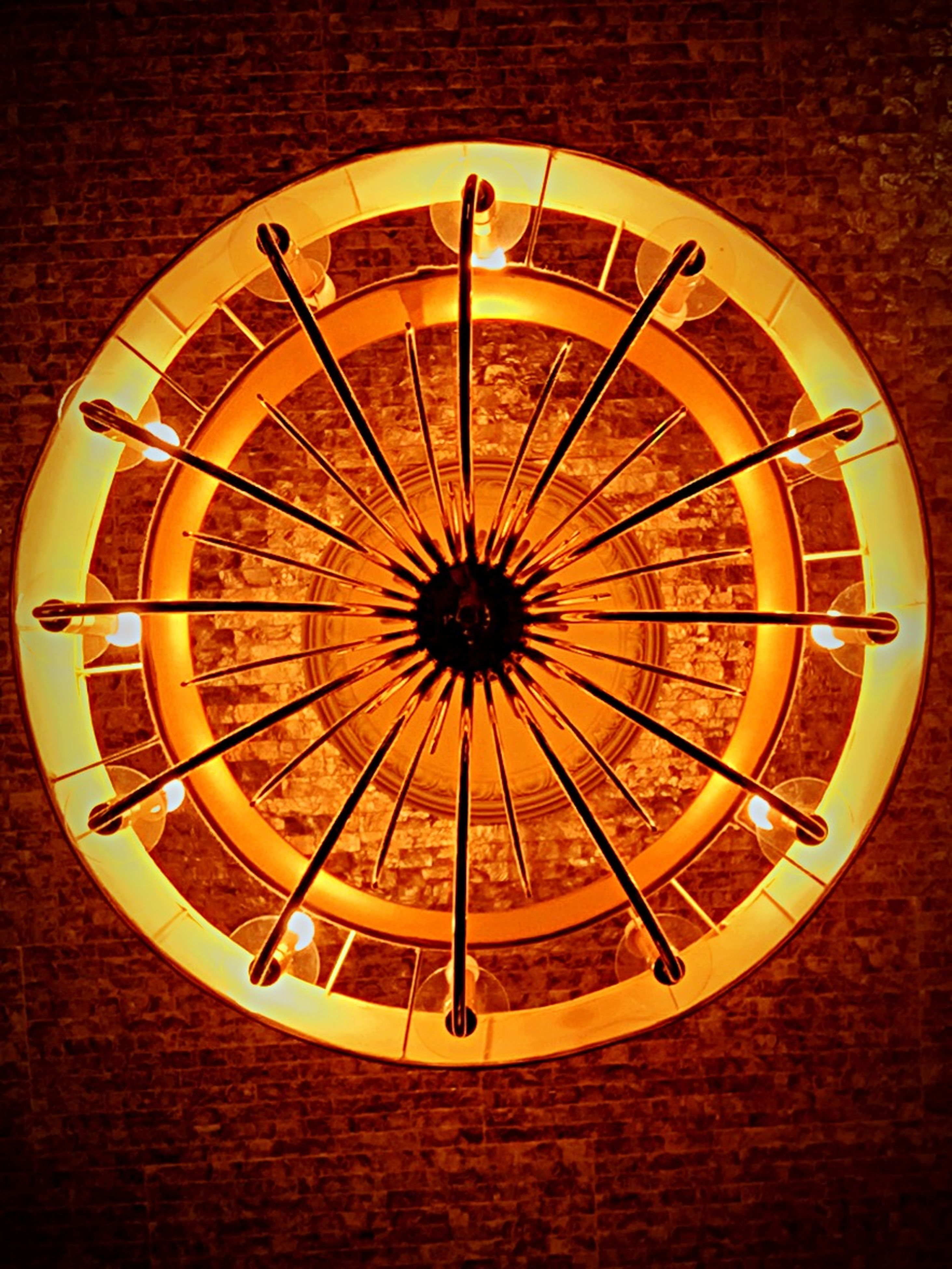 circle, indoors, geometric shape, pattern, art and craft, design, round, yellow, directly above, shape, creativity, wood - material, art, no people, close-up, clock, high angle view, time, single object, built structure