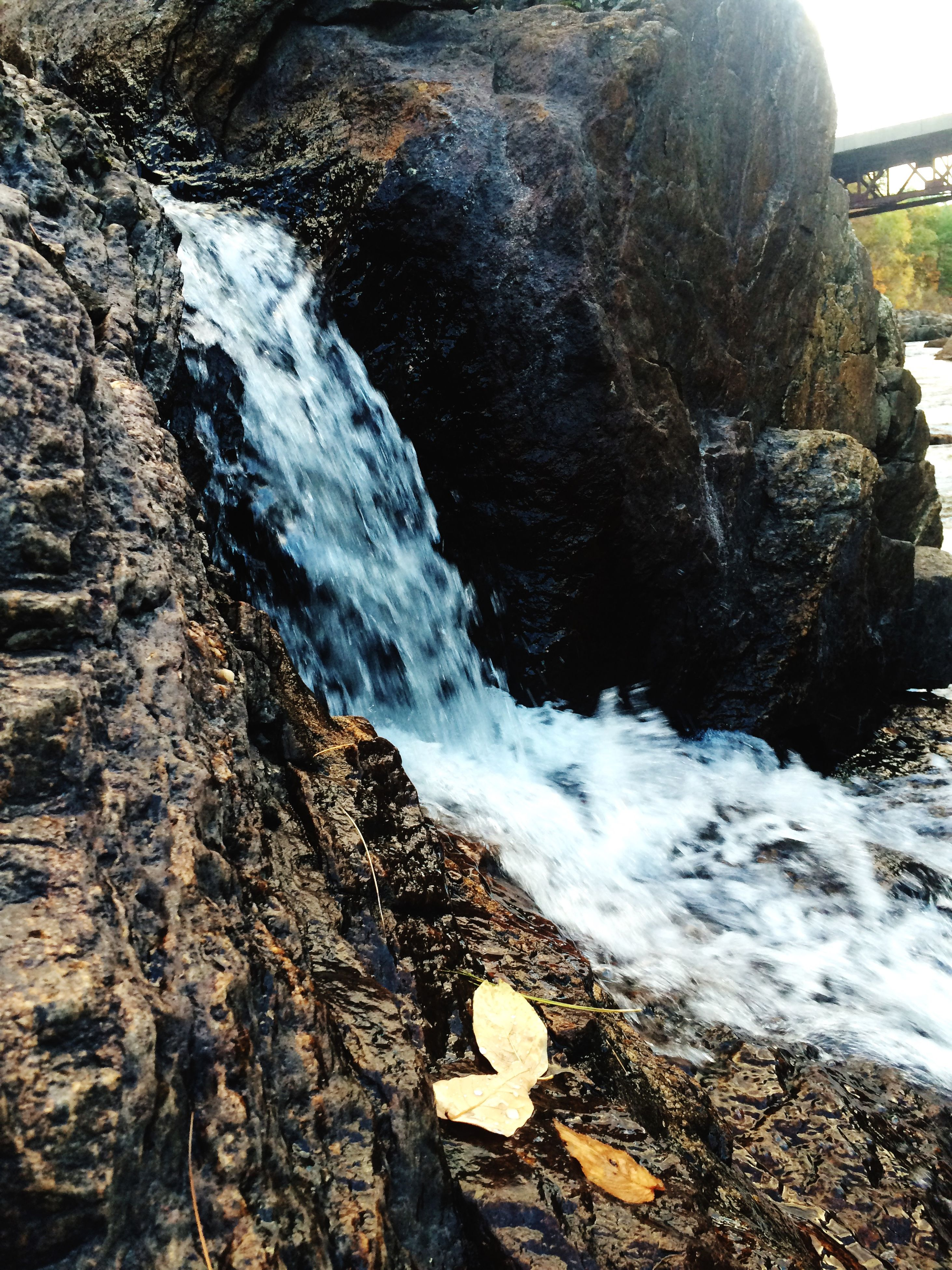 water, motion, surf, flowing water, rock - object, nature, beauty in nature, splashing, wave, long exposure, flowing, sea, scenics, waterfall, rock formation, outdoors, day, no people, high angle view, river