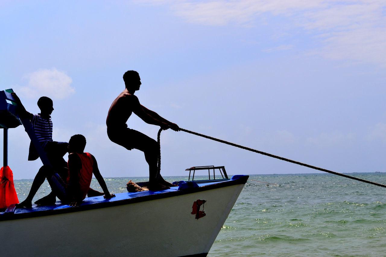 Beautiful stock photos of ocean, Boat, Cloud, Effort, Fisherman