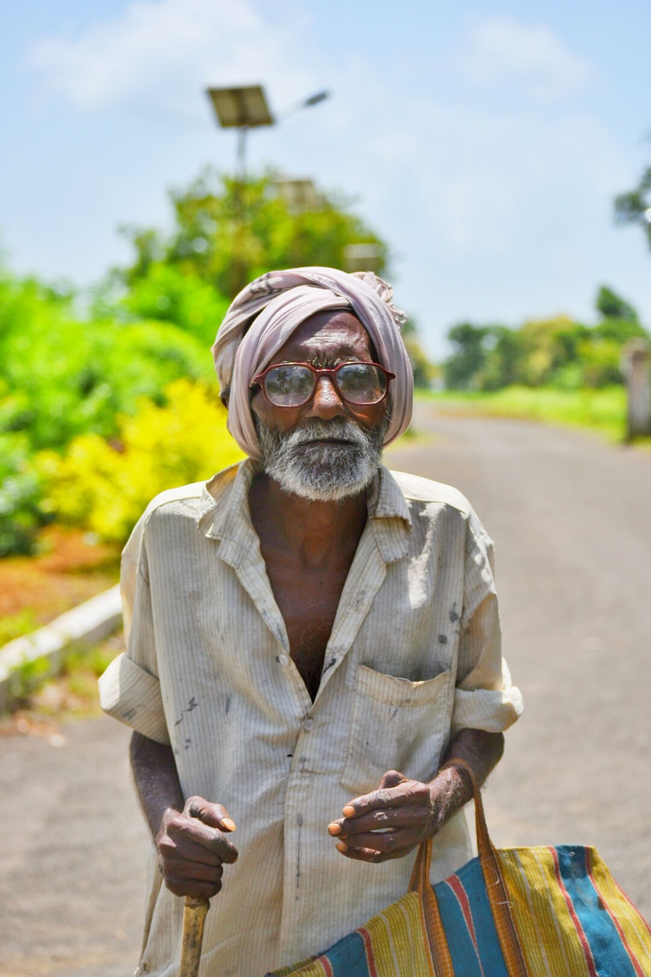 Found this old man begging at a tourist spot. It is so saddening to watch such old people wearing the cloths of poverty Looking At Camera Poverty Poverty. Looking For The Hope Of Light. Poor  Poorpeople Tourism Country Road Old Man Elderly Portrait Photography Portrait Expression Ajantacaves Ajanta Mumbai India Indian Focus On Foreground Front View Casual Clothing Looking At Camera Country Road Outdoors Day Tourism