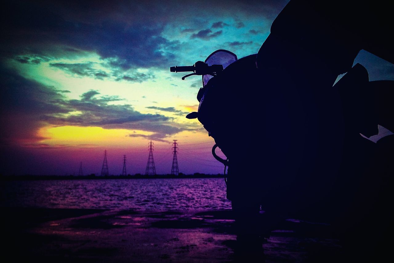 silhouette, sunset, sky, sea, beach, real people, outdoors, nature, cloud - sky, leisure activity, men, one person, holding, water, beauty in nature, one man only, day, adult, people