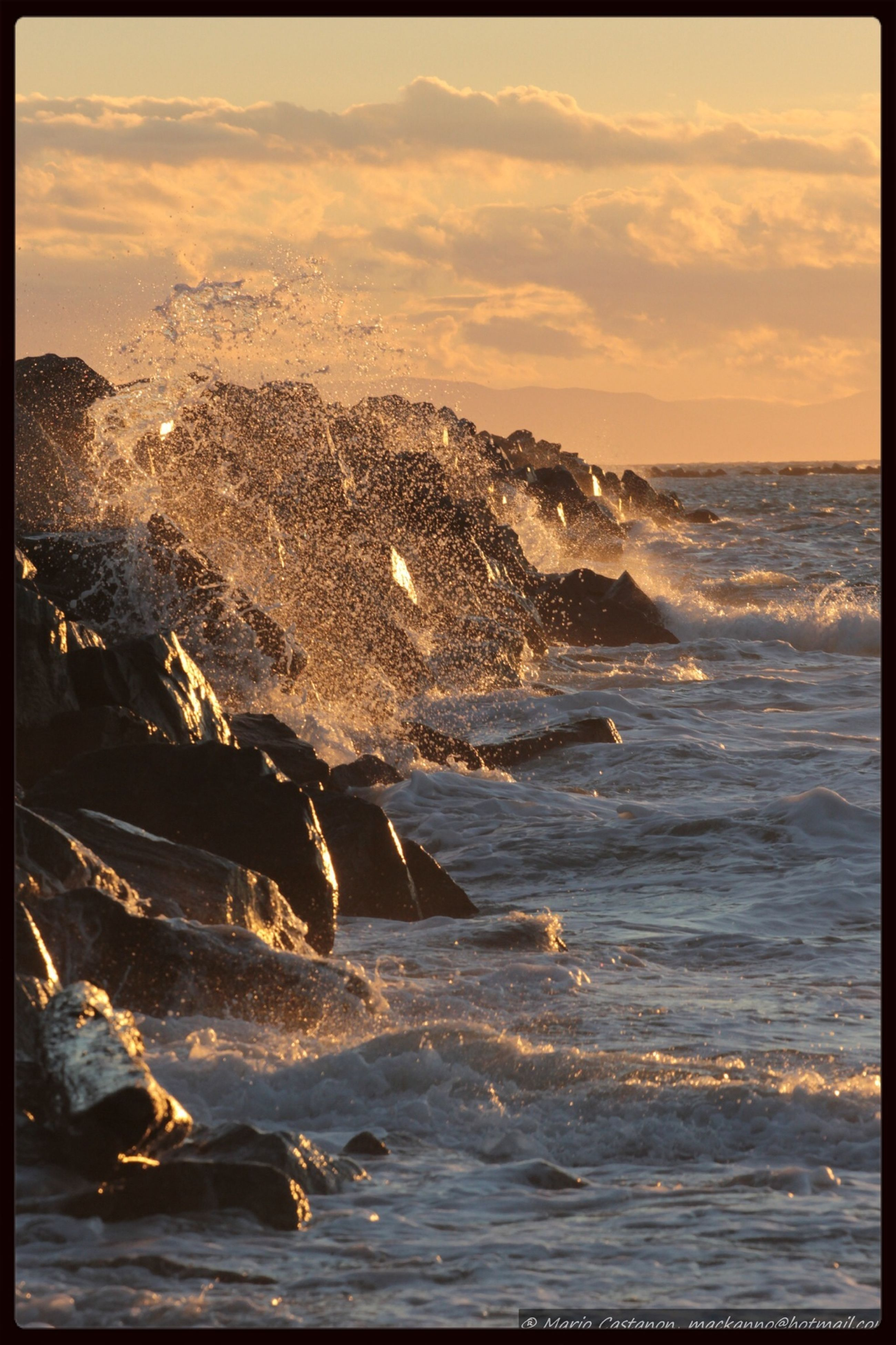 water, sea, transfer print, beach, horizon over water, auto post production filter, wave, sunset, shore, scenics, beauty in nature, surf, sky, nature, tranquil scene, rock - object, tranquility, idyllic, motion, outdoors