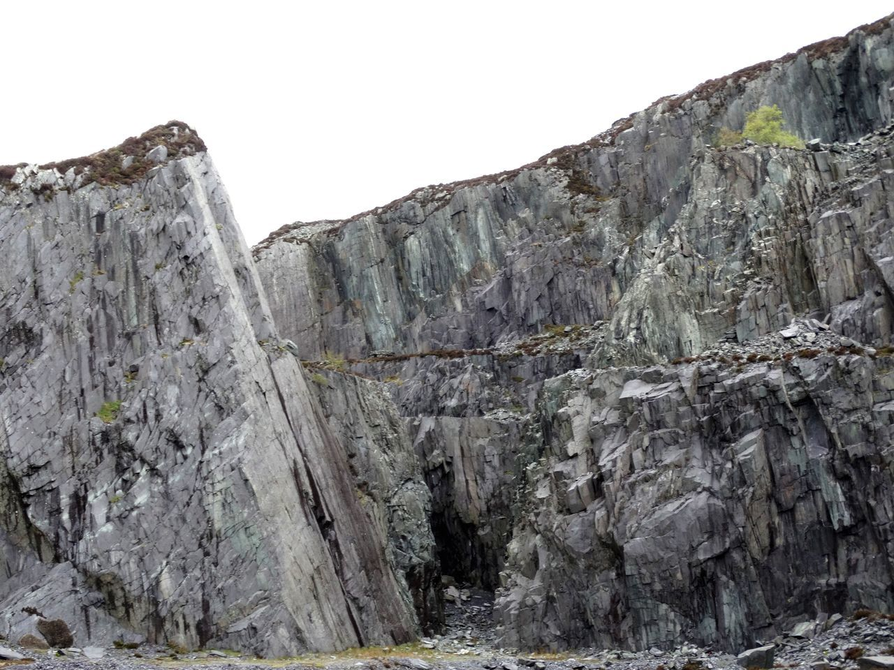 Rockface. Rock - Object Mountain Nature No People Outdoors Day Glacial Geology Physical Geography Rocks Rock Rock Formation Quarry Quarry Rock Slate Sky Gray Grey Stone Stone Material