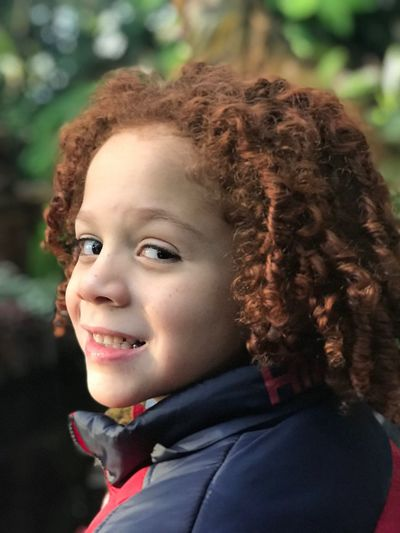 Biracial Redhead Real People Childhood Looking At Camera Curly Hair Focus On Foreground One Person Portrait Smiling Elementary Age Headshot Boys