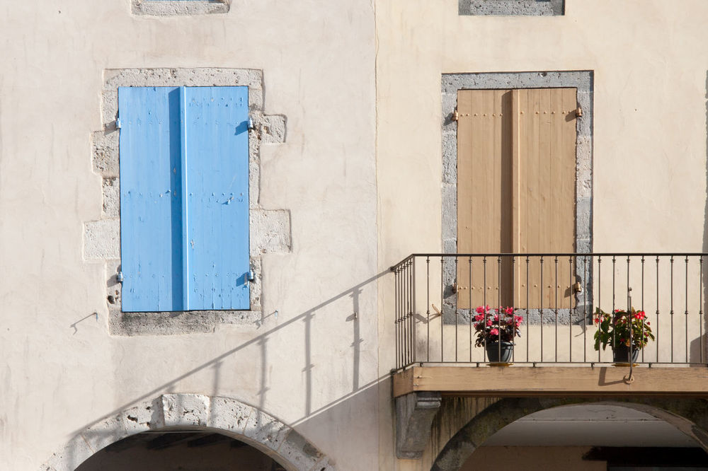 French architecture Arch Architecture Balcony Blue Building Building Exterior Built Structure Day France French Lifestyle French Village No People Outdoors Pastel Plant Residential Building Residential Structure Shuttered Windows Shutters Wall Windows