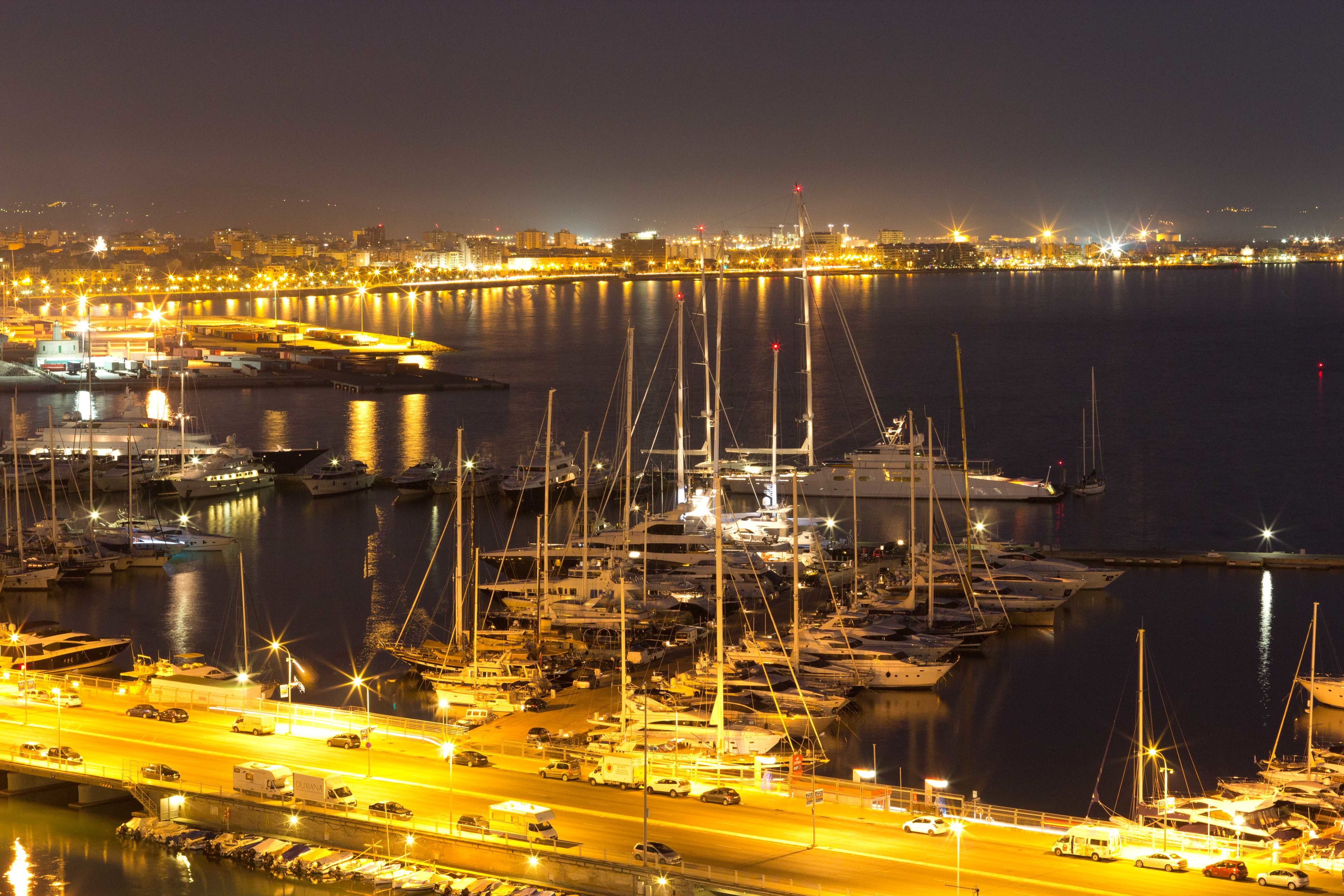 illuminated, night, nautical vessel, transportation, water, mode of transport, city, boat, cityscape, building exterior, architecture, moored, harbor, city life, sea, travel destinations, skyscraper, growth, sky, dock, urban skyline, journey, waterfront