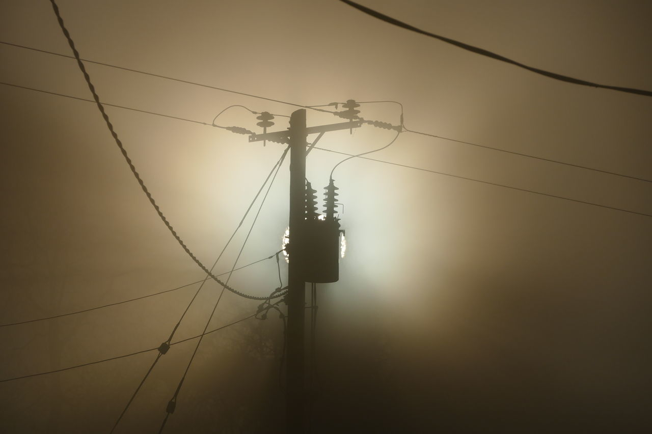 Foggy day.. Cable Connection Day Dream States Electric Pole Electricity  Electricity Pylon Ethereal Fog Foggy Foggy Weather Fuel And Power Generation Low Angle View No People Outdoors Power Line  Power Supply Silhouette Silhouette_collection Sky Softness Sunset Technology