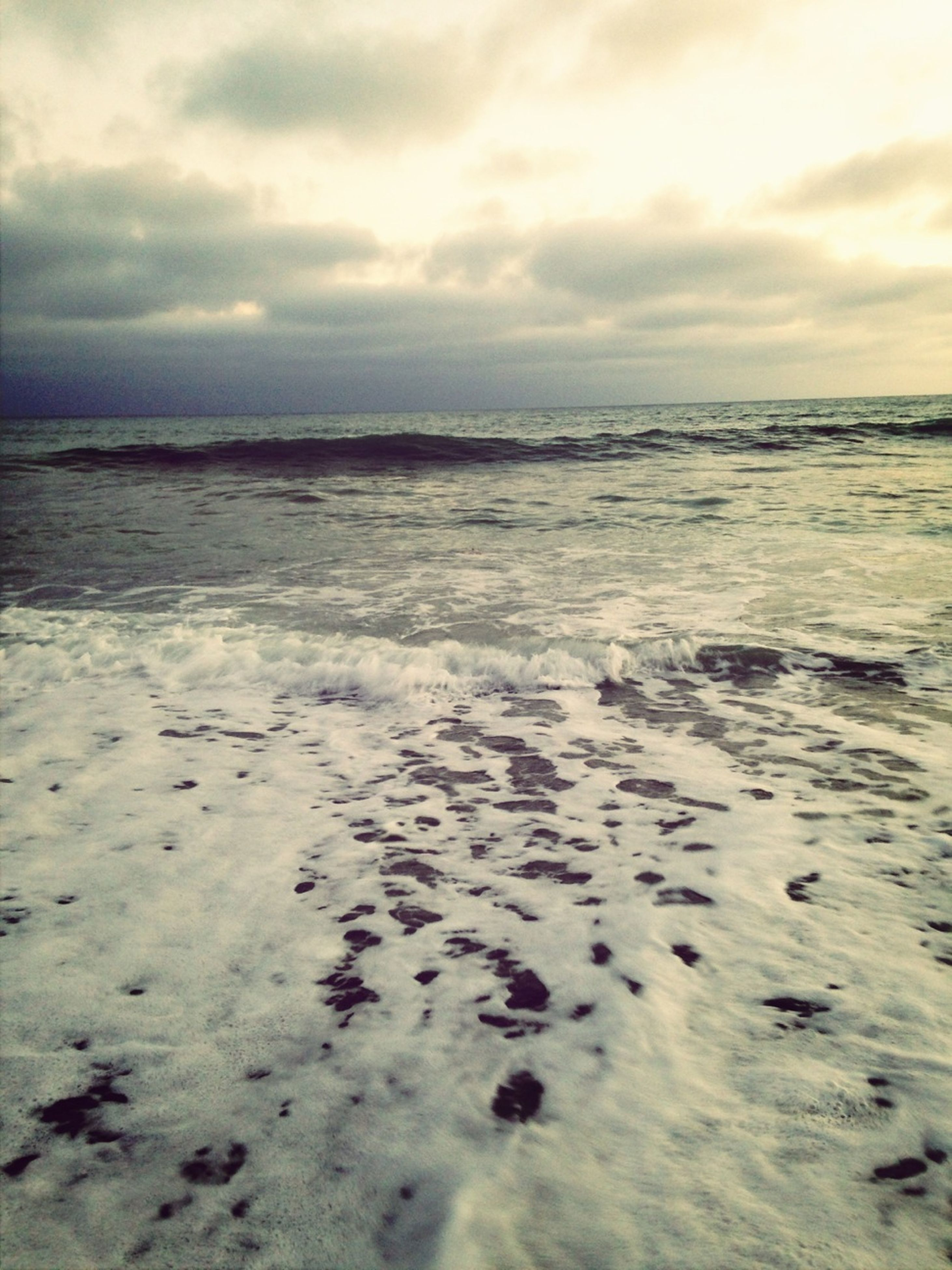 sea, water, sky, tranquil scene, scenics, tranquility, cloud - sky, beauty in nature, horizon over water, cloudy, beach, nature, weather, shore, idyllic, cloud, wave, overcast, dusk, waterfront