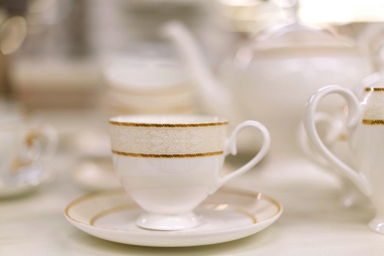 Porcelain  Indoors  Cup No People Tea Cup Porcelain  Plates Tea Set Dishes Dishes Set Shelves Shopping Retail  For Sale Arrangement Shelf White Gold Golden White Color Plate Teapot Afternoon Tea