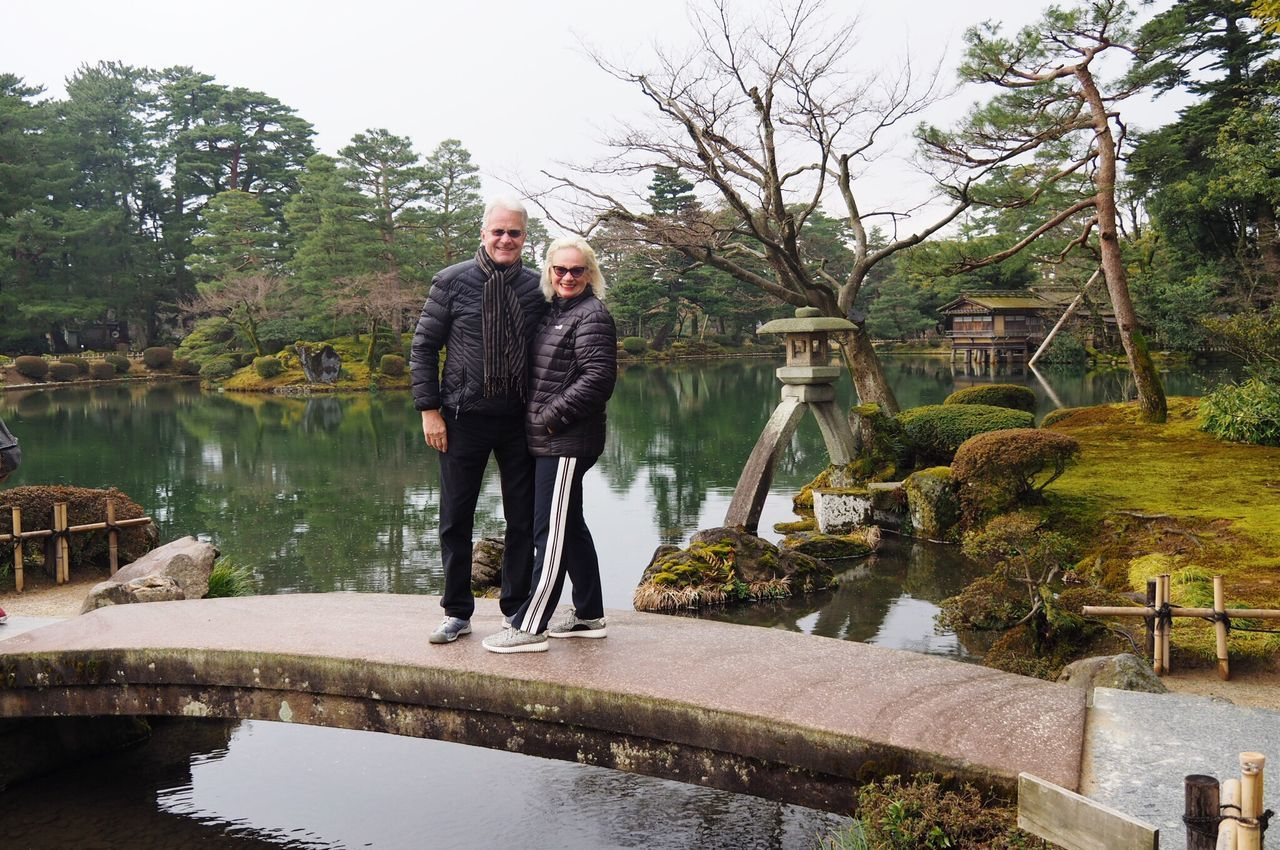 Japanese garden in Kanazawa Stonebridge Two People Full Length Togetherness Heterosexual Couple Mature Adult Mature Men Adults Only Gray Hair Mature Couple Couple - Relationship Tree Love People Reflection Water Adult Men Women Happiness Bonding Kanazawa,japan Rock - Object Japanese Style TravelDestinations