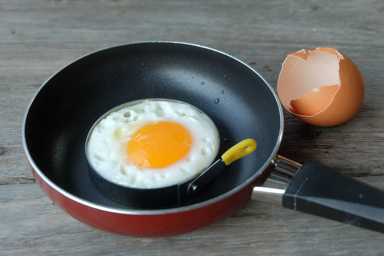 fried egg with pan on wood table Breakfast Cooked Cooking Egg Eggshell Floor Food Fried Fried Egg Fried Egg Frying Pan Material Pan Side Dish Thai Food Vintage Wood Wood Floor Wood Table
