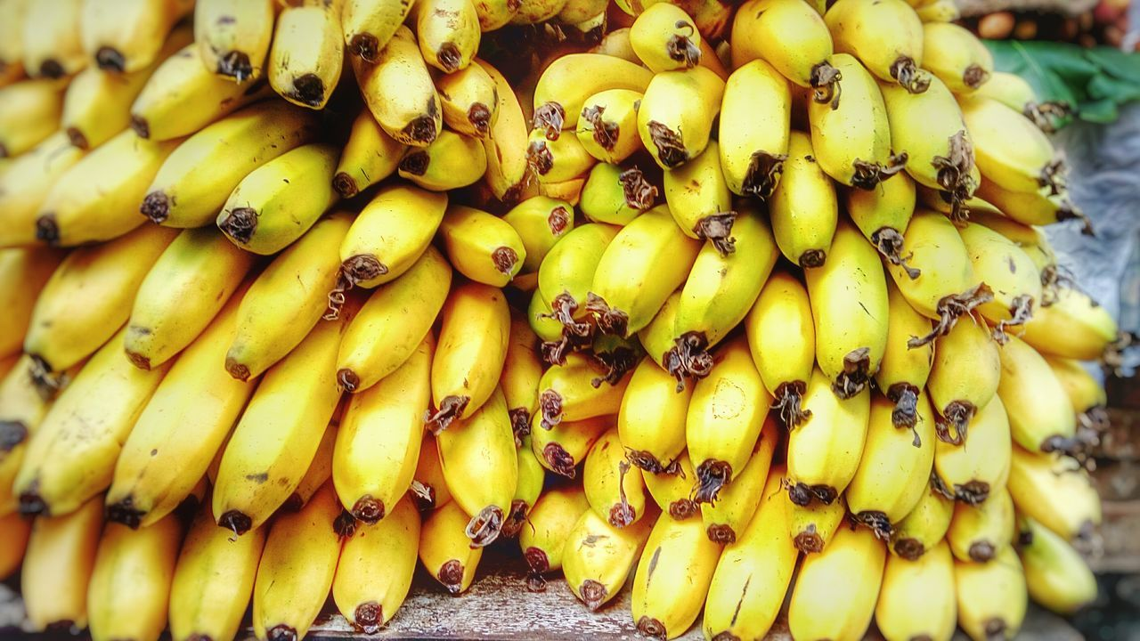food and drink, yellow, food, fruit, healthy eating, banana, outdoors, close-up, no people, freshness, day, market, nature