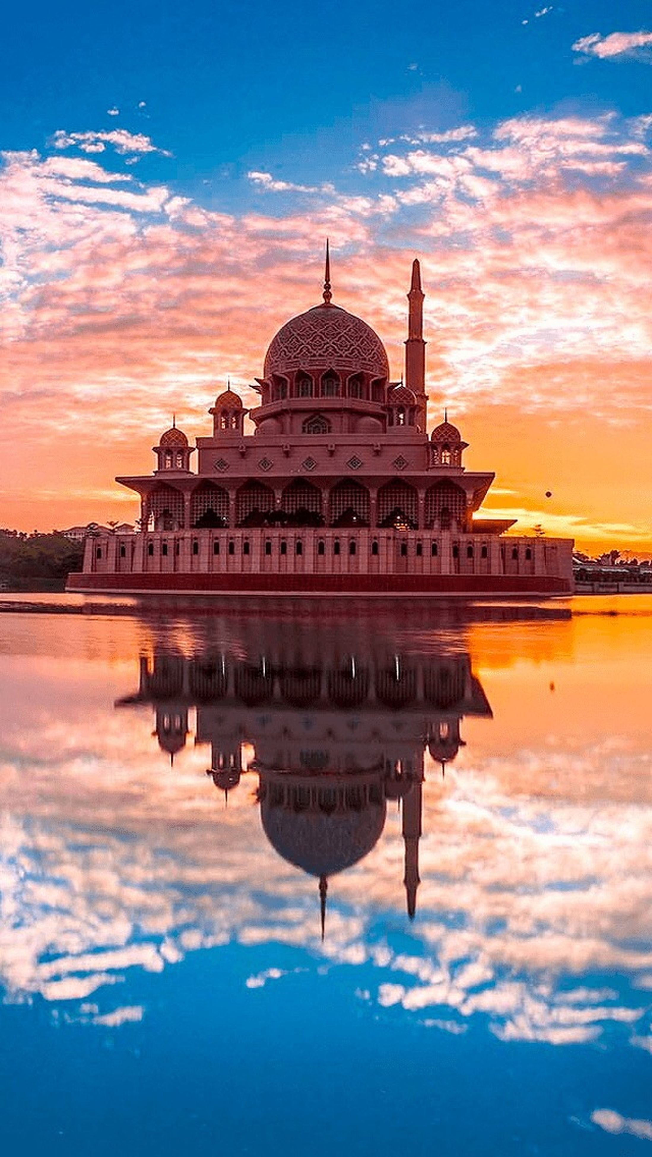 architecture, built structure, building exterior, famous place, sky, travel destinations, tourism, sunset, place of worship, dome, travel, religion, spirituality, water, reflection, international landmark, history, waterfront, cloud - sky, capital cities