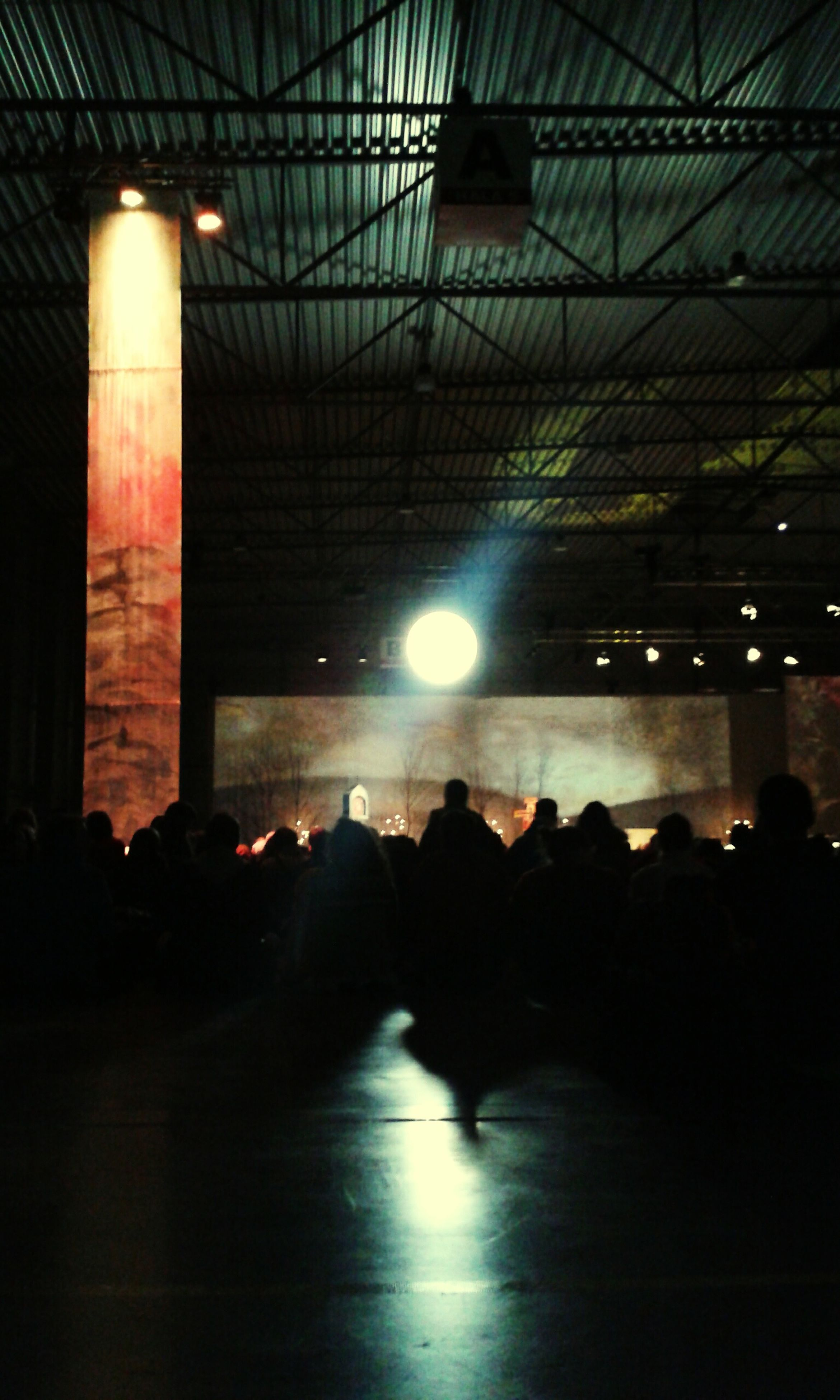 silhouette, illuminated, indoors, large group of people, men, lifestyles, leisure activity, person, night, built structure, lighting equipment, arts culture and entertainment, medium group of people, architecture, group of people, ceiling, walking, unrecognizable person, light - natural phenomenon
