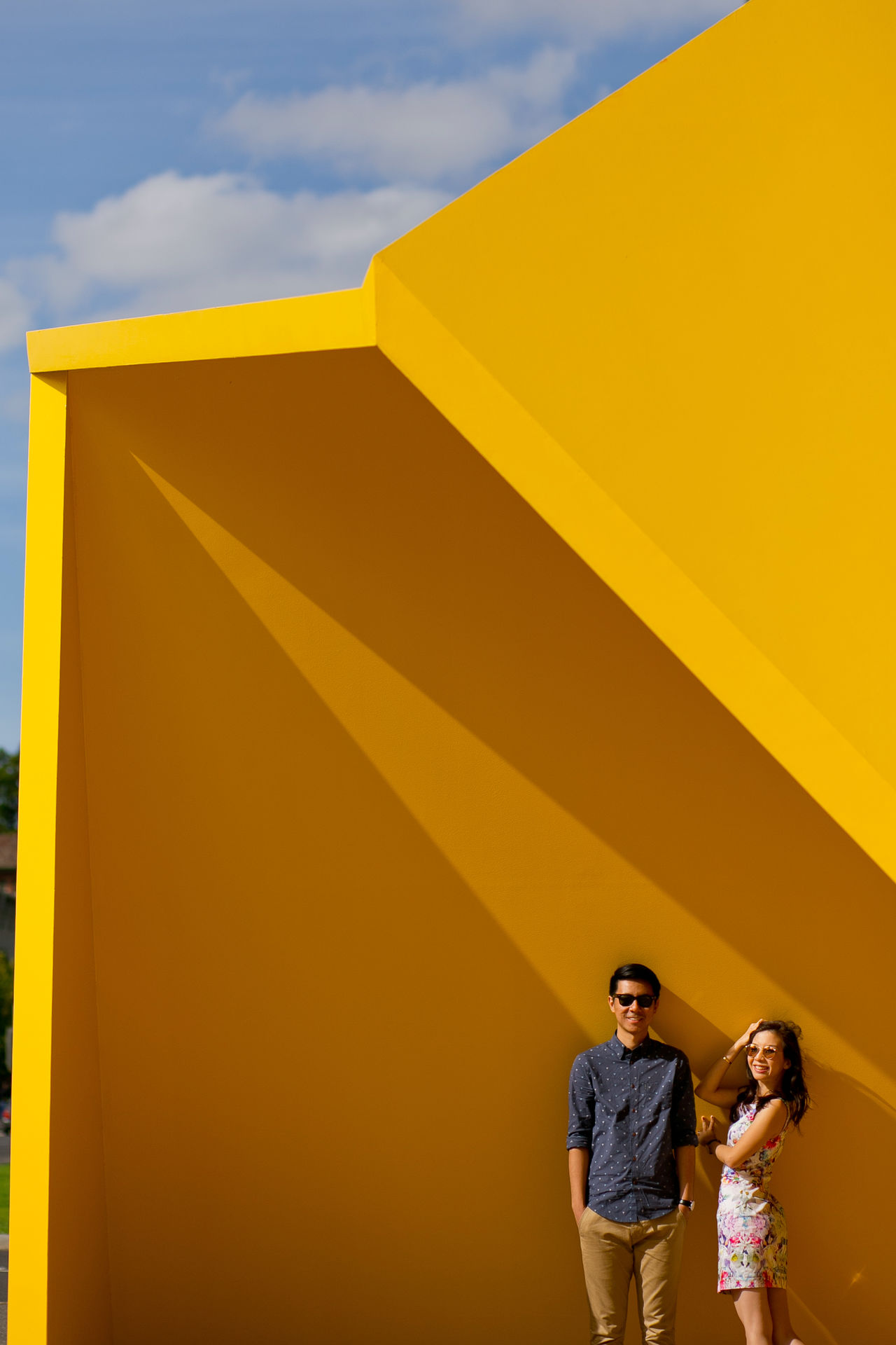 Enjoying the Sun ^^ Adult Adults Only Architecture Cloud - Sky Day Design Enjoying The Sun Light And Shadow Men Outdoors People Sky Standing Togetherness Two People Women Yellow Young Adult The City Light