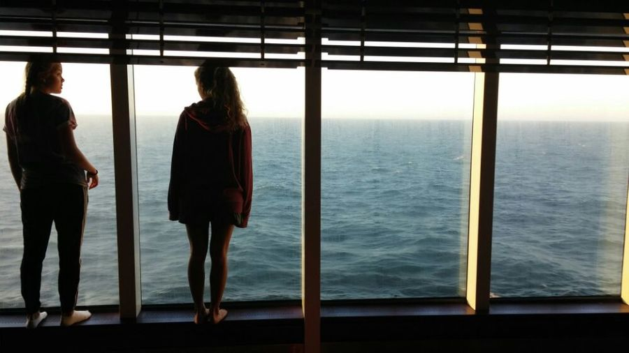 Travel Window Adult Indoors  Rear View Looking At View Looking Through Window Adults Only Travel Destinations Young Adult Women People Only Women Sea Young Women Two People Vacations Day Full Length Water Let's Go. Together.