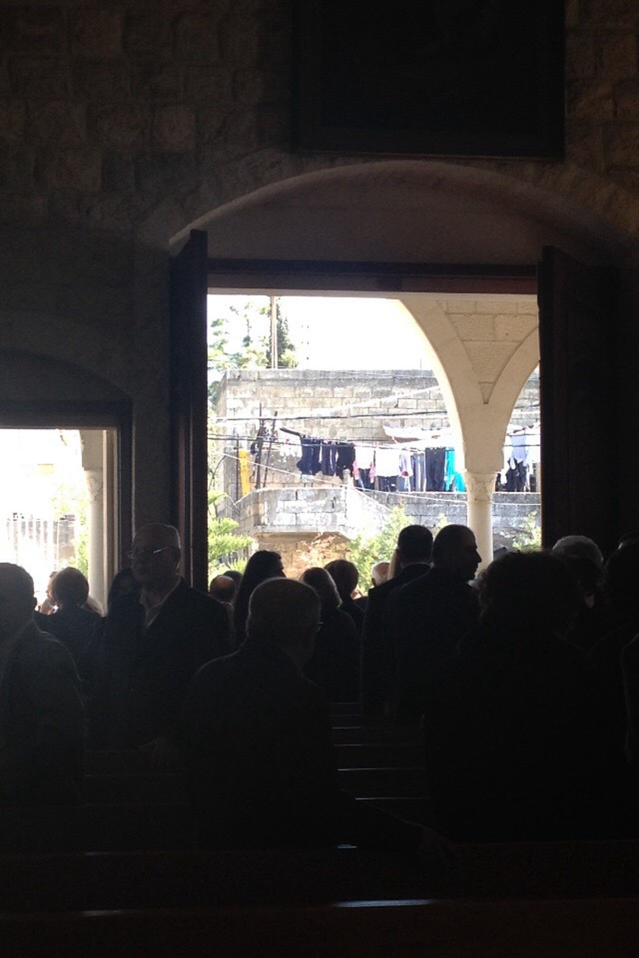 After Mass Leaving Church  Through The Door Laundry Line Village Life Lebanon East Mediterranean People