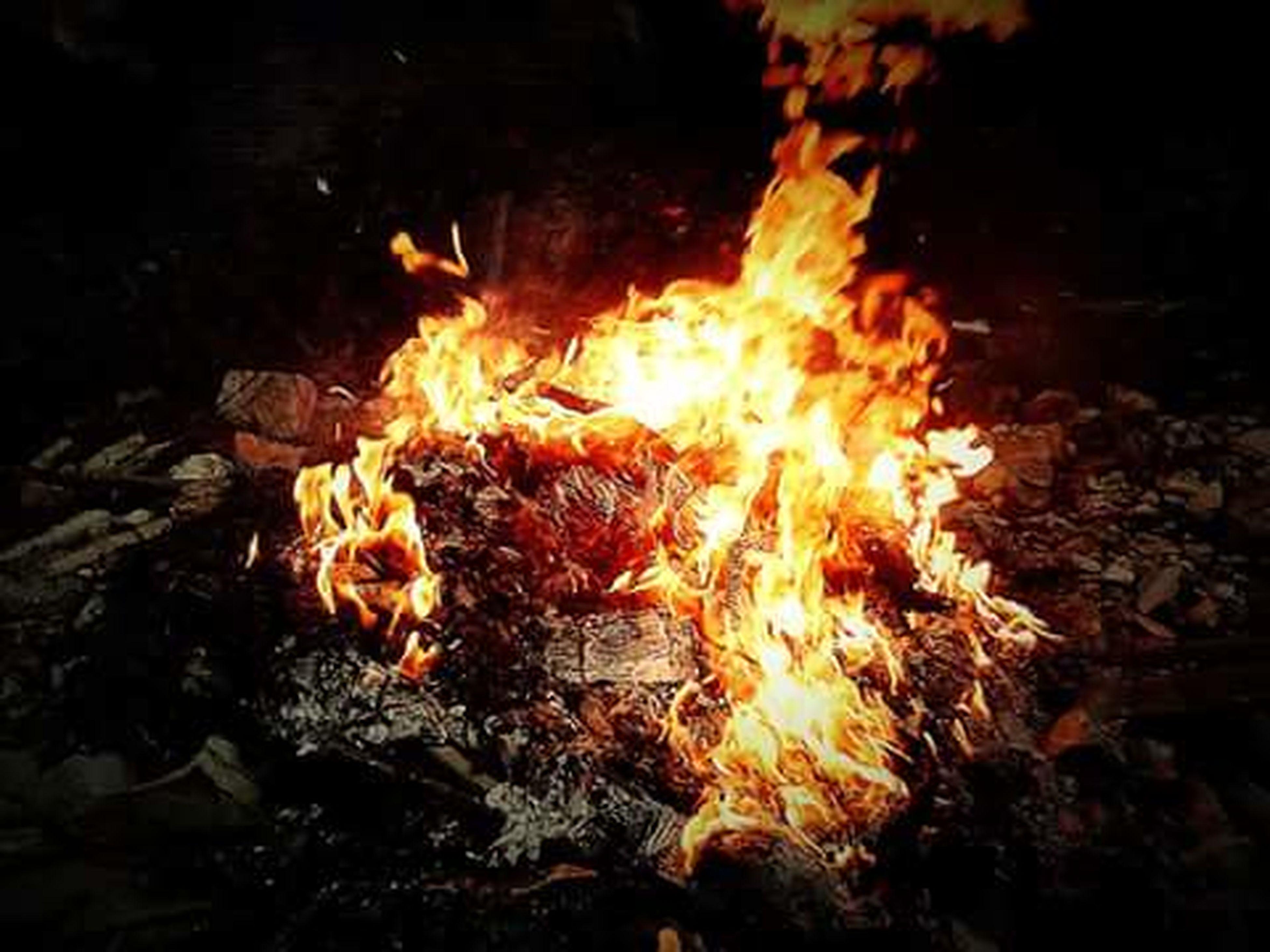 burning, flame, fire - natural phenomenon, heat - temperature, glowing, bonfire, firewood, night, fire, campfire, motion, heat, close-up, long exposure, orange color, wood - material, dark, log, no people, light - natural phenomenon