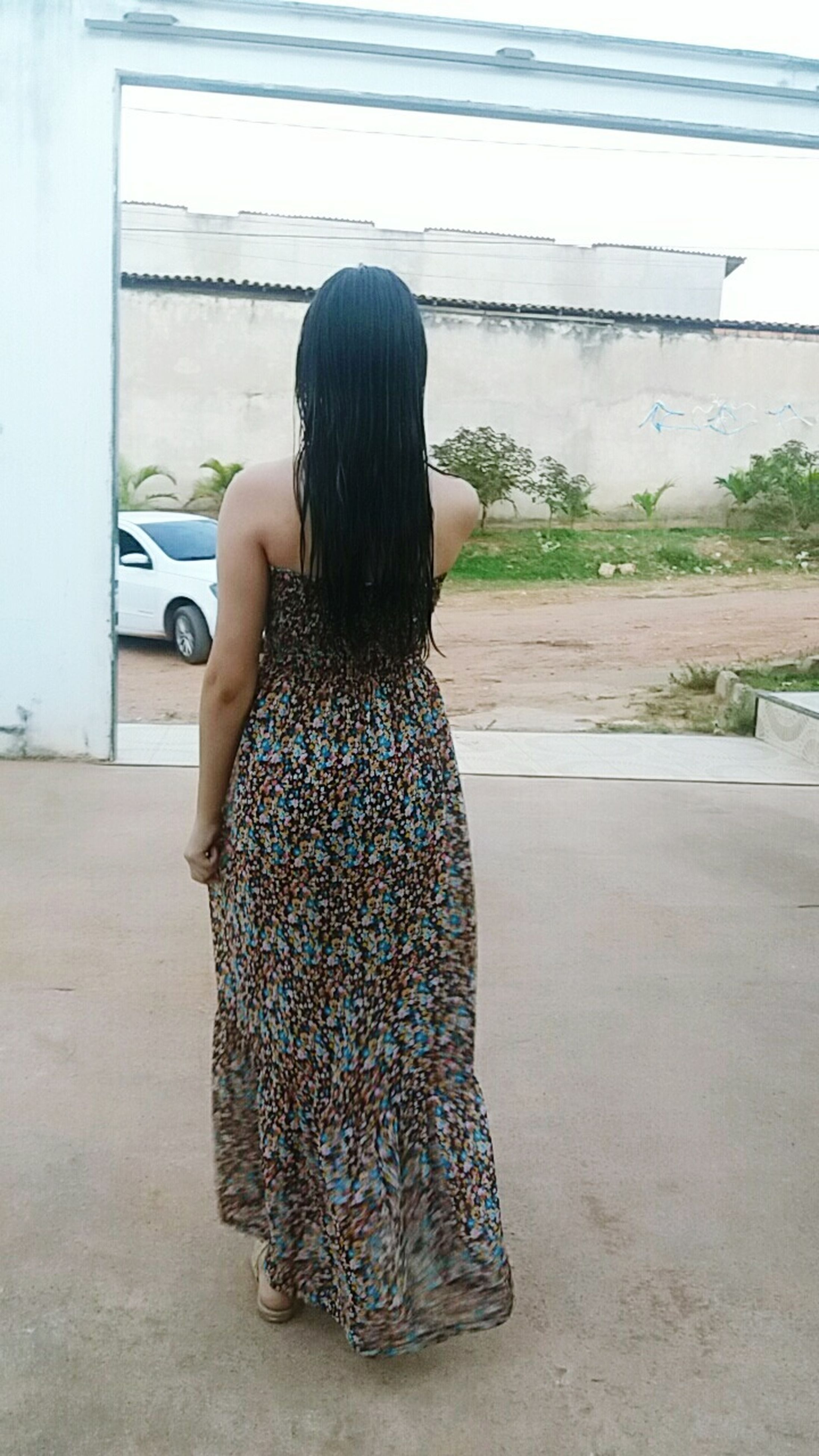 rear view, lifestyles, casual clothing, leisure activity, full length, standing, person, sitting, waist up, long hair, three quarter length, sky, day, childhood, relaxation, side view, transportation, outdoors