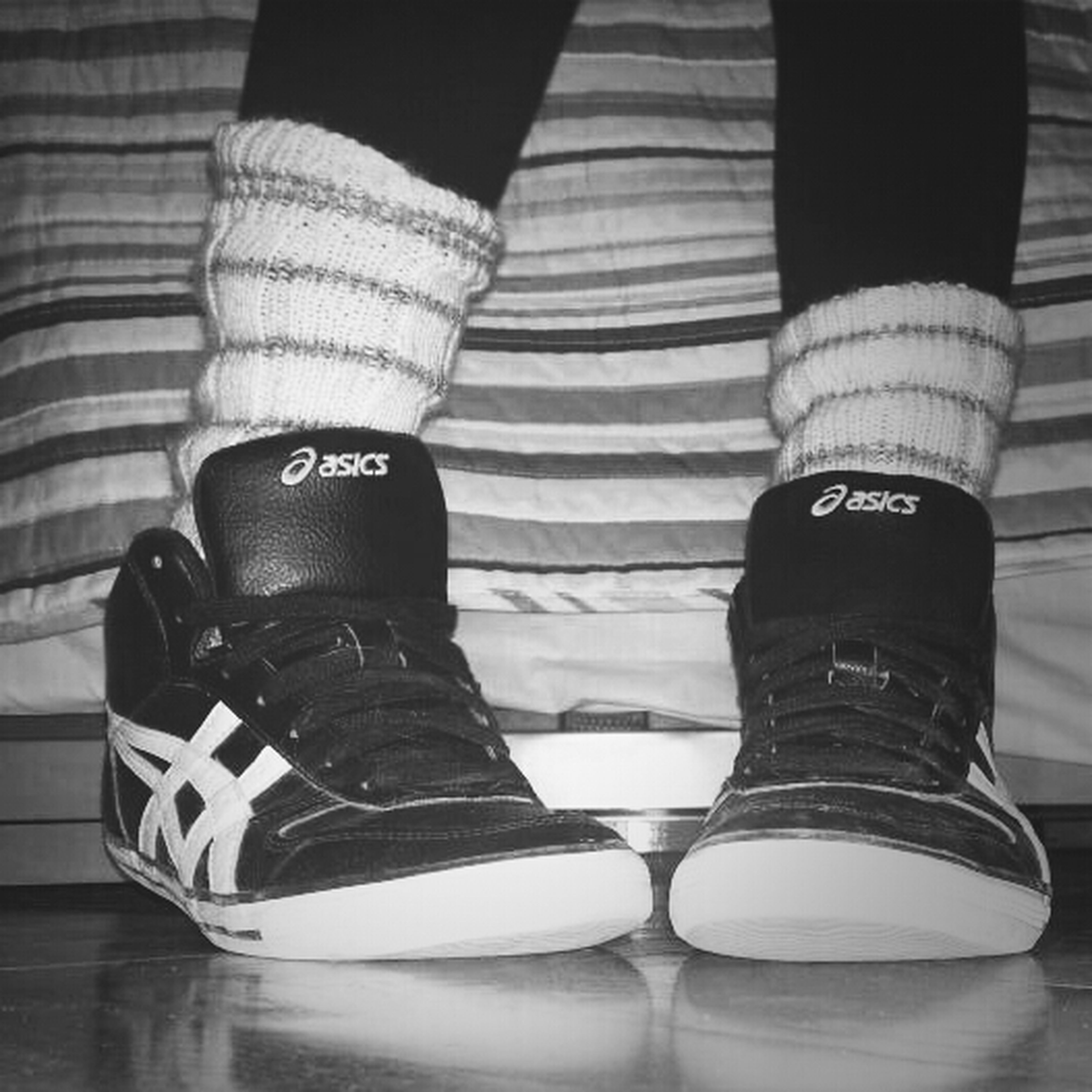 low section, shoe, person, standing, lifestyles, men, indoors, footwear, leisure activity, casual clothing, jeans, human foot, close-up, canvas shoe, high angle view