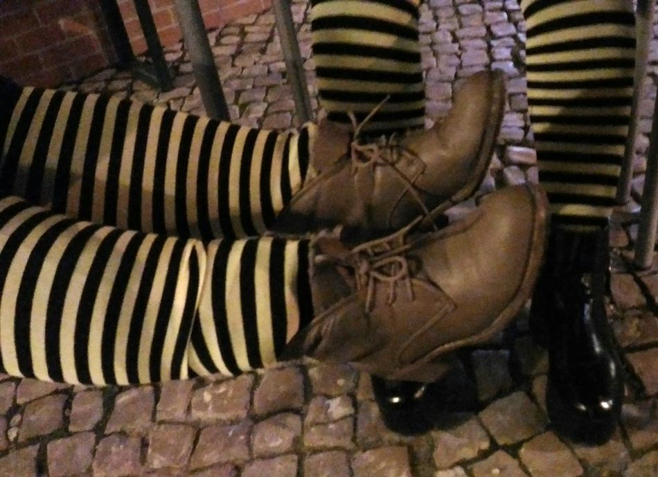 Week On Eyeem Showcase: February Four Legs Two People Yellow Socks Relaxing Moments Relaxing Under The Table Having Fun Enjoying Life Yellow And Black Brown Boots Black Boots Details Check This Out EyeEm Best Shots EyeEm Gallery Cobblestone Cobblestones Party Time Eye4photography  Carnival Colors Of Carnival Colorful Socks Color Contrast