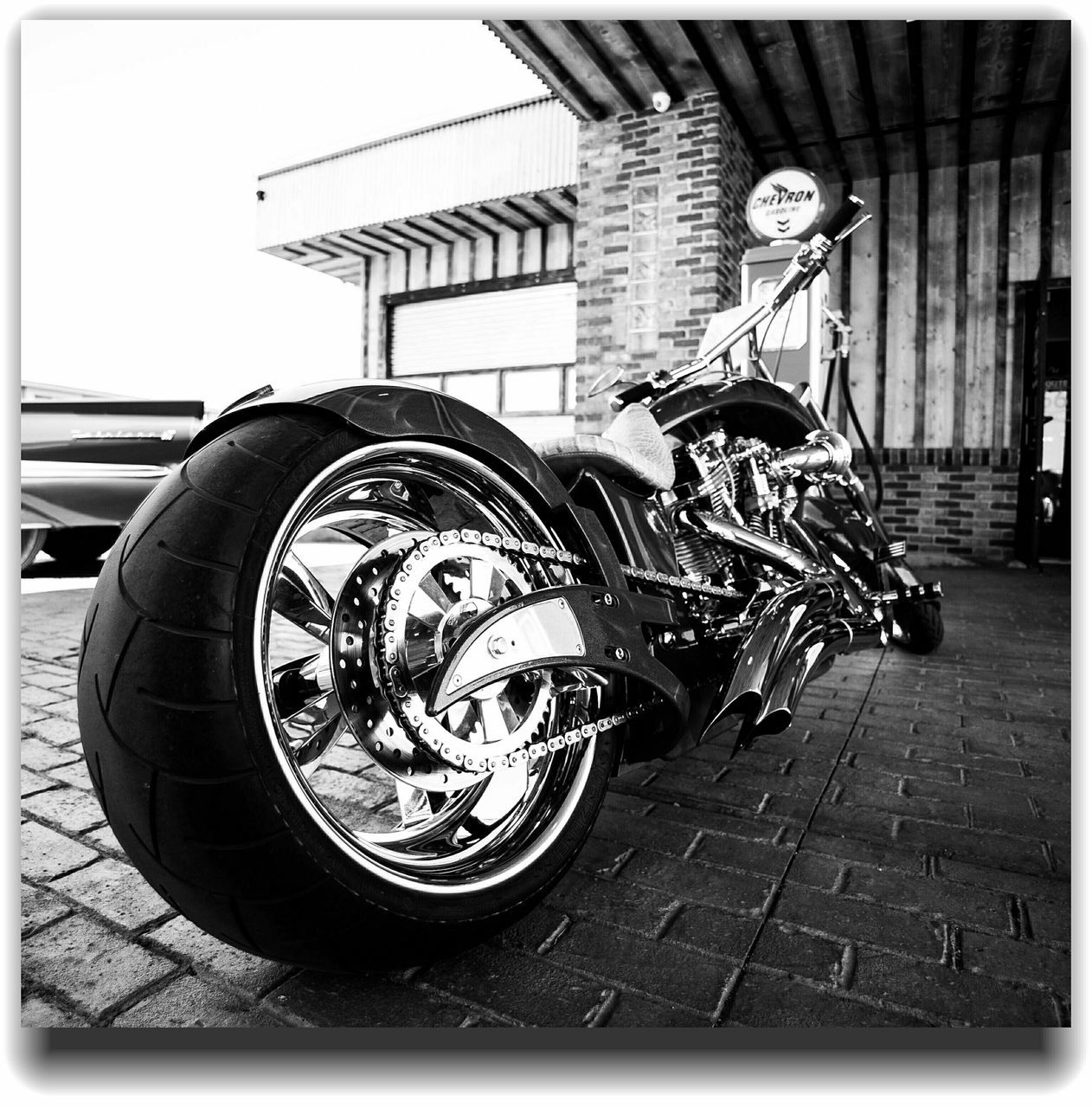 transportation, land vehicle, mode of transport, day, motorcycle, building exterior, outdoors, built structure, street, architecture, men, scooter, one person, people