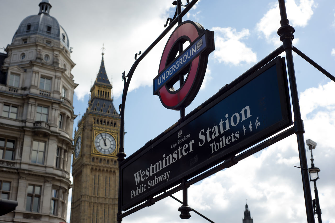London underground station entrance sign with Big Ben in the background (Westminster Station) Architecture Big Ben Building Exterior Built Structure City Clock Tower Cloud - Sky Communication Day Entrance Landscape London Underground Low Angle View No People Outdoors Road Sign S Sky Station Subway Text Travel Destinations Westminster