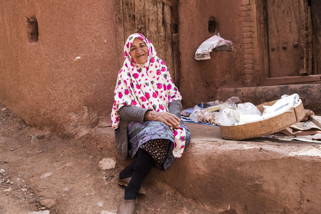 She is Omol Kolsom, she was 75 years old and she sold her hand made like vinegar and slice of apples dry , bathroom staff and washcloths.she was so happy person even she was not rich person. Abyaneh Clothes Dress Iran Iranian Iranian People One Person Outdoors People Real People The Great Outdoors - 2017 EyeEm Awards The Photojournalist - 2017 EyeEm Awards The Portraitist - 2017 EyeEm Awards Traditional Clothing Traditional Costume Women Place Of Heart